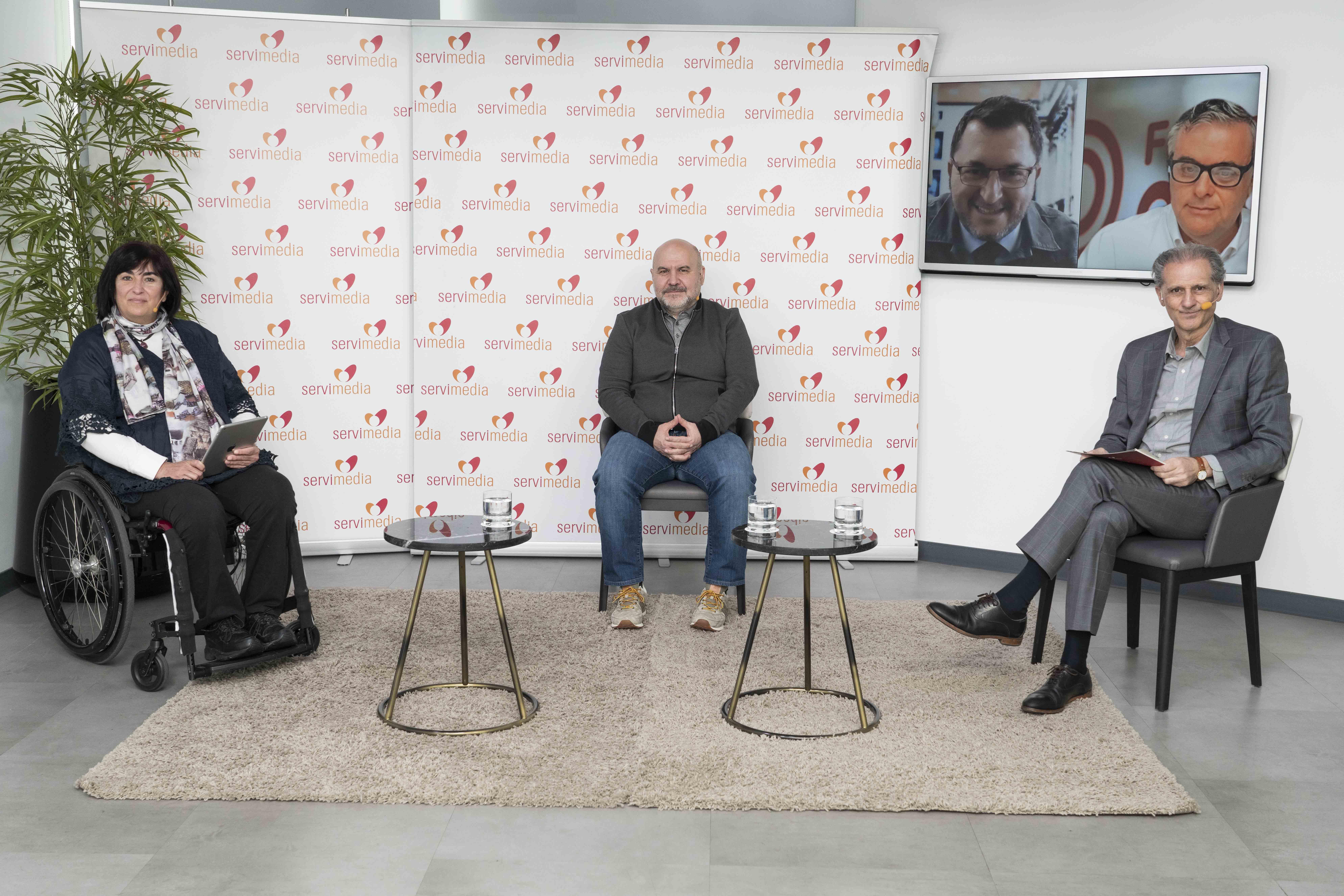 Los dirigentes de Predif, Cermi y Fundación ONCE, durante el diálogo en Servimedia | Foto: Jorge Villa